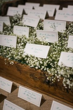 Classic wedding escort cards on baby's breath floral box