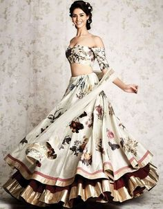71 Mind-Boggling Lehenga Designs That Will Make Your Day off-white printed layered lehenga choli Choli Designs, Lehenga Designs, Traditional Fashion, Traditional Dresses, Indian Wedding Outfits, Indian Outfits, Indian Attire, Indian Wear, Lehenga Choli