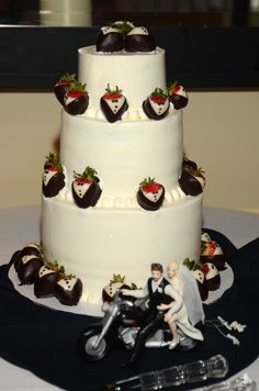 Wedding cake with just a touch of Harley Davidson.