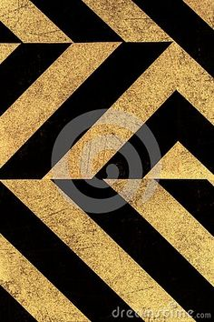 A background of black and gold striped paper.