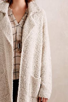Anthropologie EU Ysabelle Belted Boucle Coat by Moth. Moth relies on simple yarns and pure shapes to make a statement, and in turn appeals to women who want a feminine look without any fussiness.