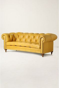 """Fun, trendy, adorable yellow leather couch from anthropologie (from """"Color of the Month: Have a Golden Autumn with Not-So-Mellow Yellow"""") This is cute, but would it be comfortable and right for our living room? Yellow Leather Sofas, Tufted Leather Sofa, Yellow Couch, Leather Chesterfield, Tufted Sofa, Red Leather, Dream Furniture, Home Furniture, My Living Room"""