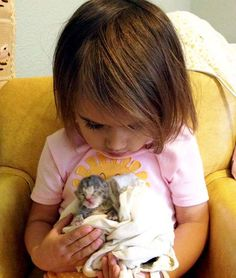 """Tiny Bottle Kitten Squirrelly Gets Second Chance -- """"My husband found an abandoned newborn kitten–placenta still attached!–and he scooped it up and brought home. I've been bottle feeding him for the past two weeks and he's grown healthy and strong. My 3 year old daughter (Isobel) thought he was a baby squirrel and so named him 'Squirrelly',"""" said Carrie C."""