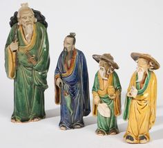 """FOUR CHINESE TERRACOTTA MUD MEN All in polychrome glazes and impressed, """"China"""".  Fine condition.  6"""", 6 1/2"""", 7 1/2"""", and 9 3/4"""" h.  In the 1890s, the U.S. began requiring all imported goods to be marked with their country of origin. A figure with a mark of simply """"China"""" or """"Hong Kong"""" is from 1890 to 1919."""