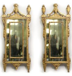 "A pair of Italian neoclassical gilt wood mirrors. CIRCA: Last Quarter of the 18th Century DIMENSIONS: 57"" h x 24"" w"