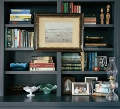 handsome dark gray painted bookcase - beautifully styled by Logan Killen Interiors