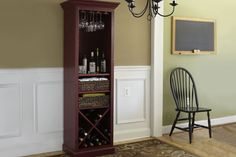 Follow our step-by-steps for building this handsome cocktail hutch, and you'll always be ready for guests with a place to hang glasses, store wine bottles, tuck bottle openers and napkins, and display spirits. | Photo: Ryan Benyi | thisoldhouse.com