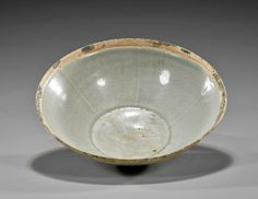 """Chinese Song Dynasty Yingqing glazed bowl; with combed and sectioned design to the interior some wear to qingbai color glaze, and with some remains of original silver rim; D: 7 1/2"""""""