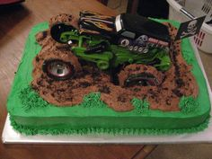 Grave Digger I cut a hole in the center of the cake for the mud hole and used chocolate buttercream Digger Birthday Cake, Digger Birthday Parties, Truck Birthday Cakes, 3rd Birthday, Birthday Ideas, Digger Party, Grave Digger Cake, Chocolates, Cakes For Boys