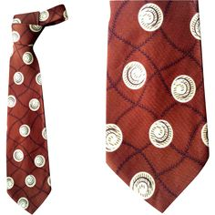 1950s Wide Vintage Necktie by Arrow Classy Print on Brown by ARROW.  Measurements in inches 50-1/2 inches long x 4 inches wide. These colors are so