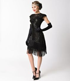 Feel like creating an atmosphere, darling? The stunning Del Mar Flapper is made for mavens on the move. An elegant 1920s dress in a lightweight sheer black mesh with subtle lining that creates a sweetheart bodice while an illusion neckline gives a high ne