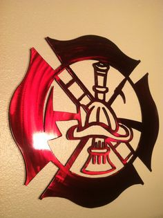 I absolutely love this!  Custom Firefighter Maltese Cross by CustomMetalWorks on Etsy, $70.00