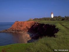 Quintessential Prince Edward Island, Canada - red dirt cliffs, green growing stuff, bluest water & sky, and a lighthouse! Oh The Places You'll Go, Places To Travel, Places To Visit, Vacation Spots, Dream Vacations, Canada Real Estate, Just Dream, Prince Edward Island, Beautiful Places