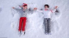 Louis and Harry make snow angels. | 17 One Direction Dolls Who Came Alive At Night