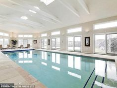 Incredible: The Olympic sized pool sits beneath vaulted ceilings, surrounded by glass door...