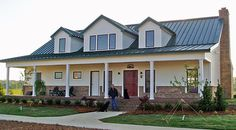 Residential Metal Buildings, Metal Homes, Workshops, Garages, Storage Buildings Aloha Tiki Creations - Jacksonville, Florida Tiki Huts, Tiki Bars, Palm Trees, Metal Buildings, and RV Condos