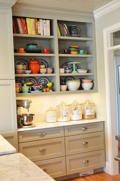 Or a small section to display a few dishes and cookbooks in the kitchen!