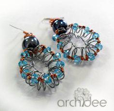 impara a creare orecchini con le spirali per rilegatura: tutorial riciclo creativo, servono solo cristalli filo metallico e monachelle tutorial passo passo