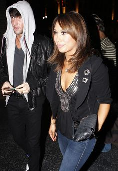 Cheryl Burke Medium Layered Cut - Cheryl sported shoulder-length layers with long, center-parted bangs. Her honey highlights complemented her tan and big brown eyes.