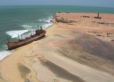 Abandoned ship at the Sahara desert and beach in Mauritania