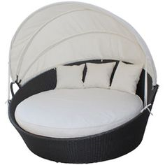 @Overstock - Awaken from your daytime repast while comfortably ensconced in this boundless elliptical daybed. Return to newly focused strength and vigor with an affluent all-weather white cushion and retractable sun guard.http://www.overstock.com/Home-Garden/Siesta-Outdoor-Rattan-Espresso-with-White-Cushions-Canopy-Bed/6671012/product.html?CID=214117 $1,119.99