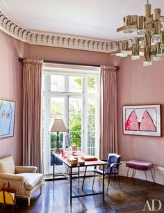 In the study, a midcentury Adnet leather desk and armchair are grouped with a René Prou stool upholstered in a Manuel Canovas silk; the artworks are by Philip Guston