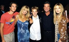 Goldie Hawn and Kurt Russell pose in 2000 with their brood of young actors: Oliver Hudson, who stars in sitcom 'Rules of Engagement'; Wyatt Russell, who has done film work; and Kate Hudson, made famous by her performance in 'Almost Famous'. Oliver Hudson, Kate Hudson, Celebrity Couples, Celebrity Photos, Goldie Hawn Kurt Russell, The First Wives Club, Black Puffer, Young Actors, Almost Famous