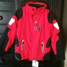 Spyder Ski Jacket, YOUTH 14/Womens sm-med SPYDER Ski Jacket, red, white and black.  YOUTH 14 (although I'm a women's medium and it fits me fine).  Worn once, but we now live in Fl.  Perfect condition, super soft.  Three  zippered pockets on outside, enclosed pockets on inside with snap enclosures on inside as well.  Would make a perfect christmas gift, especially for skiing or just cold days. Spyder Jackets & Coats
