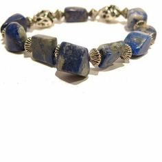 """Lapis Bracelet 03 Stretch Blue Pyrite Silver Gemstone Crystal Healing Lazuli I Dig Crystals. $50.00. Lapis: deep peace. Chakra: Third Eye. One-of-Kind: handmade gifts by I Dig Crystals are made in the USA. Measures: approx 7""""L x 10mm. Art Jewelry: natural lapis gemstone stretch bracelet"""