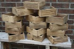 Barn wood flower boxes. I'm thinking maybe making a bunch of these with pallets instead of buying buckets? We could have small ones and just a few large ones full of baby's breath? Save money! What do you think @Courtney Shoemaker