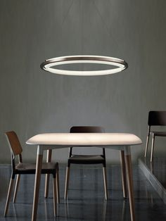 Suspension Light - The 'Nimba' LED suspension light from designer Antoni Arola is an intriguing piece that mimics the shape of a halo. The ethereal light . Cool Lighting, Modern Lighting, Lighting Design, Lighting Stores, Suspended Lighting, Modern Lamps, Overhead Lighting, Industrial Lighting, Light Luz