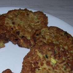 My FAVORITE thing to do with zucchini.  I just made this recipe for the second time last night and I got a pile of fritters.  The best part is that I put all my leftover fresh herbs, and some cheeses in it.  I also made them super healthy using a gluten free flour and frying them in coconut oil.  I'll have no guilt eating these fried treats.