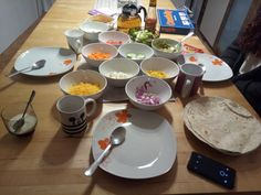 A idea for Girls Night at home. Gathered many ingredients for self made wraps. Anyone can do it.  Quickly done and extremely delicious. Including fun with friends whilst cooking! We used #cheddar #onions #tomatoes #cucumber #garlicsauce #guacamole #feta #carrots #salad #corn  You can use as many ingredients as you wish and fill every wrap differently. Tasty and entertaining.  Worth a try ;)