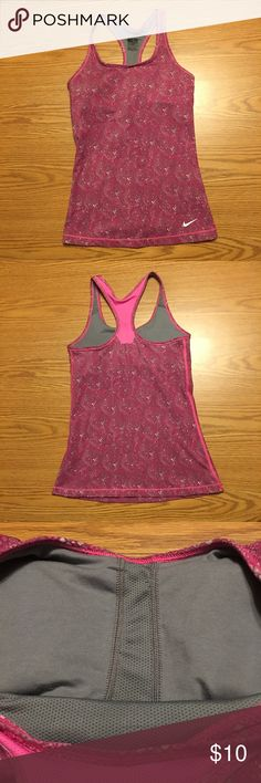 New Year Sale ‼️Nike Dri-Fit Yoga Top This is a beautiful pink and gray Nike Dri-Fit yoga top with a built in shelf bra with removable pads (included). It has been worn and wash according to the care instructions once. There are no visible imperfection! Excellent like new condition. Nike Tops Tank Tops