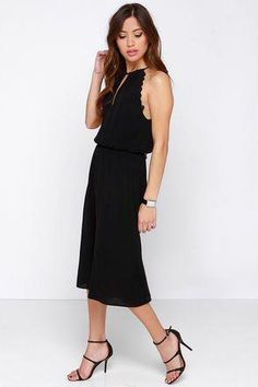 47196c0a26c7 We can t get enough of the Back Again Black Midi Jumpsuit with its  drawstring halter neck