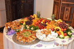 Beautiful Persian deserts table. All yummy fruits and pastries.