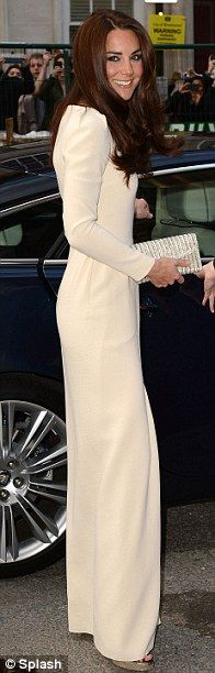The showstopping gown is believed to be a 2009 creation by designer Roland Mouret paired with Jimmy Choo shoes
