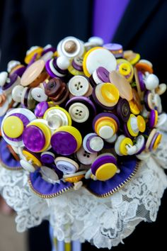 Wedding theme: Lovebirds Wedding colours: purple & yellow  My wedding buquete, made with buttons
