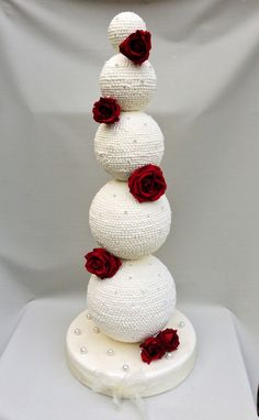 A 5 Tier sphere cake styled with crystals www.tablescapesbydesign.com…