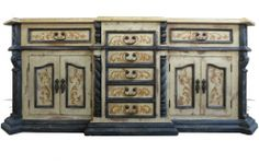 This Eclectic Vanity Teddy is an exotic blend of noticeable flair. This piece features decorative wrought iron hardware, ornate hand painted golden scrolls, decorative scroll and spiral columns, a stair step base and feminine molding designs. It is custom made in Peru and is constructed using the mortise and tenon method and from environment friendly woods and materials so that The Koenig Collection can provide eco-friendly products to you.