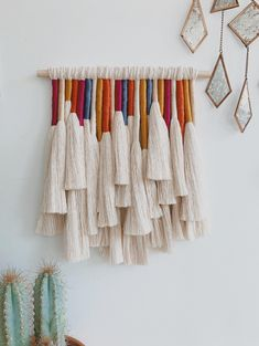 A macrame wall hanging made with fine combed cotton rope and cotton thread creates a unique work of modern boho art. This colorful woven wall hanging is a beautiful piece of art for a living room, above a bed, in a hallway, or even in a kids bedroom. Yarn Wall Art, Yarn Wall Hanging, Wall Art Decor, Diy Wall Decorations, Wall Hangings, Hanging Art, Hanging Beds, Rainbow Decorations, Hanging Chairs