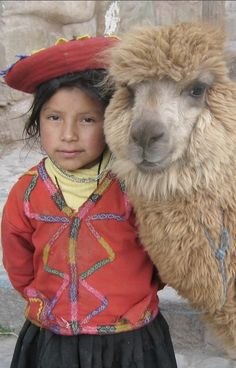 Peruvian girl posing with her alpaca near the Plaza de Armas in Cusco, Peru • photo: Donkeet on Wikipedia