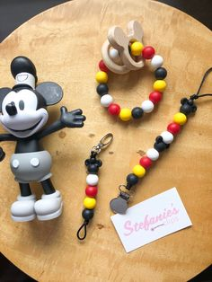 Perfect for keeping baby's pacifier or teether by their side. Pacifier clip with Cherry, Yellow, Black and Snow silicone beads Black Mickey Teething Pacifier, Teething Jewelry, Teething Beads, Pacifier Holder, Pacifier Clips, Pink Minnie, Dollar Store Crafts, Bead Crafts, Baby Gifts