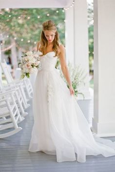 This white beach wedding dress features ruched detail on the slim chiffon bodice with wide straps, long chiffon skirt drapes with chapel train, floral lace appliqued on the tulle skirt gives feminine beauty. Back zipper closure.