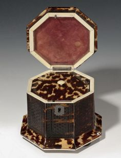A rare octagonal pressed tortoiseshell tea caddy of small size, each side with an unusual pressed decoration, with silver stringing and escutcheon, and ivory banding, with single interior tortoiseshell lid.