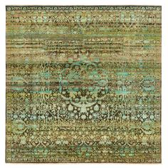An allover pattern of exotic motifs is executed in luminous shades of mint on this one-of-a-kind wool and silk rug from the Alchemy collection. The striated field of mossy green, teal, and chestnut hues form an intriguing backdrop to the ornate aesthetic. Excess yarn is re-carded and re-spun in India, upcycled into a new material, the spontaneous bursts of color within evoking the artistic sensibility of a painter's brushstroke.  <br/><br/> Traditional motifs are tr...