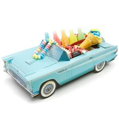 Classic Cruisers® 56 Ford Thunderbird Carton with Candy by Chevrolet. $6.99. Paperboard carton ships flat, easy fold assembly. All candy comes individually wrapped. Candy may slightly vary based on availability. Assembled Carton Measures: 5W x 11D inches. Includes over 1/2 lb of Penny & Novelty Candies. Make your next kids party a day to remember with this 1956 Ford Thunderbird Gift Baskets. Easily assemble this 56 Thunderbird Carton and fill with the included nosta...