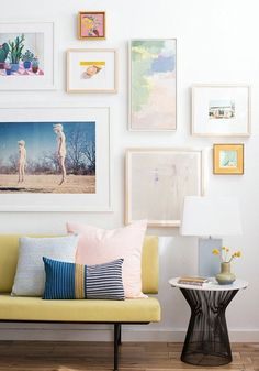 Love the idea of living in an inspired and colorful space? A simple way to add impact to a room is by hanging an art collection on a blank wall. Click for even more ideas on how to stylishly display your favorite collections—from cookbooks to vintage items, your collection will add style to any room of your home!
