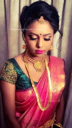 Nikitha, our dusky beauty, looks gorgeous for her reception. Makeup and hairstyle by Vejetha for Swank Studio. Pink lips. South Indian bride. Eye makeup. Bridal jewelry. Bridal hair. Silk sari. Bridal Saree Blouse Design. Indian Bridal Makeup. Indian Bride. Gold Jewellery. Statement Blouse. Tamil bride. Telugu bride. Kannada bride. Hindu bride. Malayalee bride. Find us at https://www.facebook.com/SwankStudioBangalore