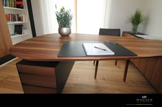 Large, wooden, round office table/desk. Arbeitszimmer : by Wagner Möbel Manufaktur